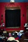 The Center window of a wonderful 3 bay window set.  Sadly the Speedway lights shine through 24-7.. hence the drapes.